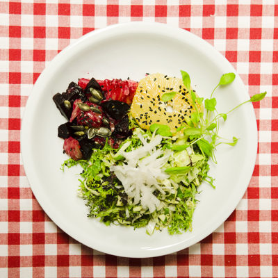 Crunchy Green Salad Leaves with Sticky Dates and Juicy Oranges served with Roasted Beetroot and Pomelo Salad.