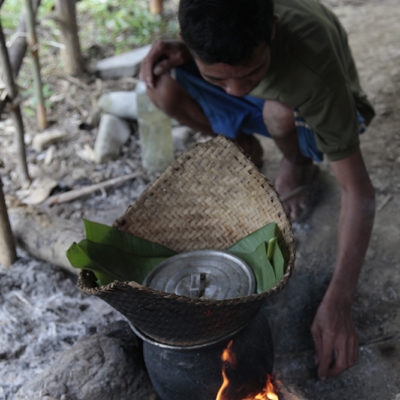 Sticky Rice being prepared outside the hut.